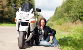Woman near a motorcycle Royalty Free Stock Photography
