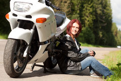 Woman near a motorcycle Royalty Free Stock Images
