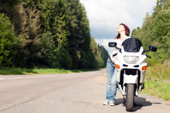 Woman near a motorcycle Stock Photo