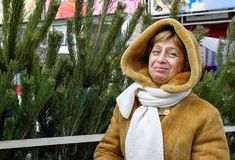 Woman near New Year tree Royalty Free Stock Photography