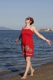 Woman near the ocean. Stock Photos