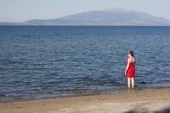 Woman near the ocean. Stock Photo