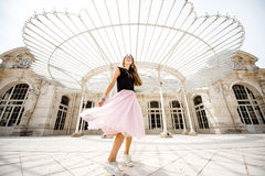 Woman near the old beautiful building in Vichy city, France Royalty Free Stock Photography