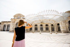 Woman near the old beautiful building in Vichy city, France Royalty Free Stock Photo