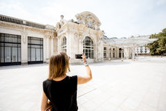 Woman near the old beautiful building in Vichy city, France Stock Images