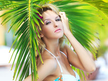 Woman near palm tree Royalty Free Stock Photo