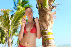 Woman near palm tree Stock Photos