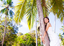 Woman near palm tree Royalty Free Stock Photography