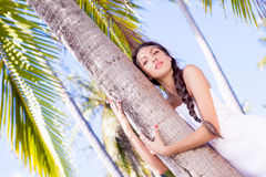 Woman near palm tree Stock Photo