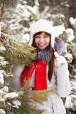 Woman near pine  in winter Stock Photo