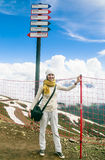 Woman near pointer runs in the ski resort Sochi, Russia Stock Photography