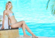 Woman near pool Stock Photo