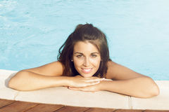 Woman near the pool Royalty Free Stock Photos