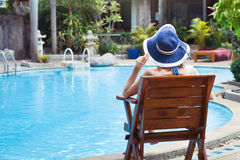 Woman near the pool. Summer holidays, woman relaxing in beautiful luxury hotel near swimming pool Stock Photo