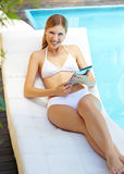 Woman near pool with tablet Royalty Free Stock Photography