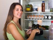 Woman near refrigerator Stock Image