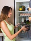 Woman near refrigerator Stock Photography