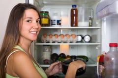 Woman near refrigerator Royalty Free Stock Photography