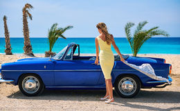 Woman near retro cabriolet car Stock Photos