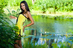 Woman near the river Royalty Free Stock Images