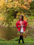 Woman  near the river in autumn season Royalty Free Stock Photo
