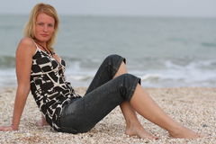 Woman near sea. Beauty well-dressed woman near sea Stock Photography