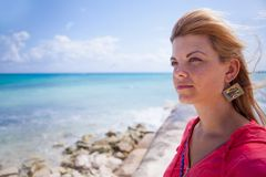 Woman near the sea. Portrait of a young woman standing on the beach Stock Photography