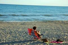 Woman near sea on the beach Royalty Free Stock Image