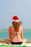 Woman near sea in santa hat Stock Photos