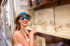 Woman near the showcase with watches Royalty Free Stock Photography