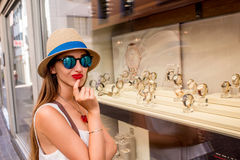 Woman near the showcase with watches Stock Photography