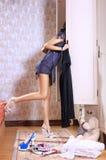 Woman near sliding-door wardrobe. Young woman near sliding-door wardrobe with bed linen Royalty Free Stock Image