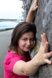 Woman near stone wall Stock Image