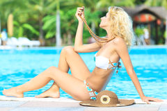 Woman near swimming pool Royalty Free Stock Photography