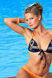 Woman near swimming pool Royalty Free Stock Images