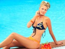 Woman near swimming pool royalty free stock image