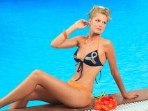 Woman near swimming pool stock image