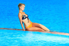 Woman near swimming pool stock images