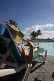 Woman near swimming pool in cuba Stock Photo