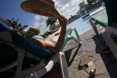 Woman near swimming pool in cuba Stock Photos