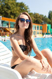 Woman near swimming pool Stock Photos