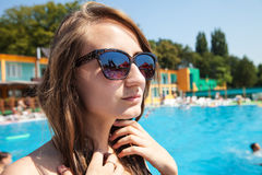 Woman near swimming pool Royalty Free Stock Photo