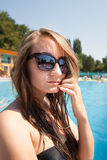 Woman near swimming pool Stock Photography