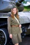 Woman near the tank royalty free stock photo