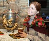 Woman near traditional russian samovar Royalty Free Stock Photography