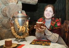 Woman near  traditional russian samovar Stock Photography