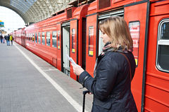 Woman near train checks his ticket on station Stock Images