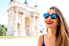 Woman near triumphal arch in Milan Stock Photo