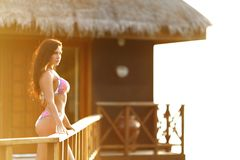Woman near tropical hotel Royalty Free Stock Photography
