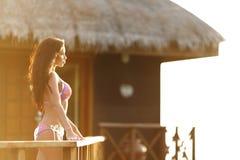 Woman near tropical hotel Royalty Free Stock Photos